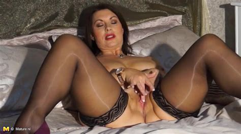Shiny Stockings On A Sexy Mature Chick In Lipstick