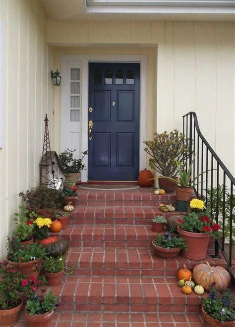 pale yellow house with blue door front doors