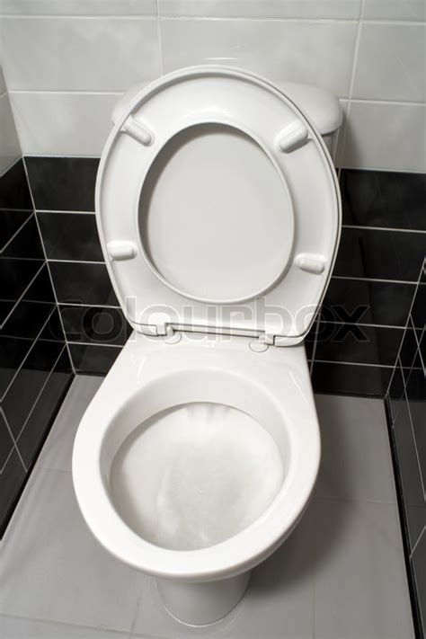white toilet bowl  open toilet seat cover stock