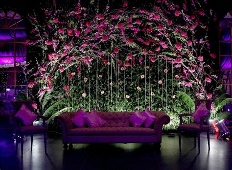 hanging orchids and light purple large outdoor wedding