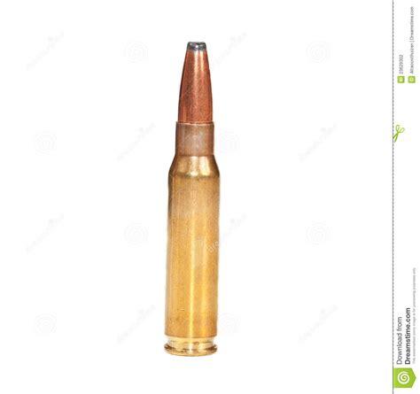 single rifle bullet  white surface stock photo image