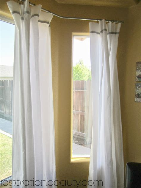 Sheer Curtains For Traverse Rods by How To Hang Sheer Curtains In A Bay Window Curtain