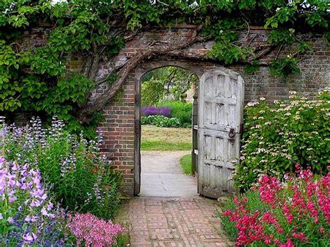 a secret garden secret garden an old wooden door leads into a garden scene flickr