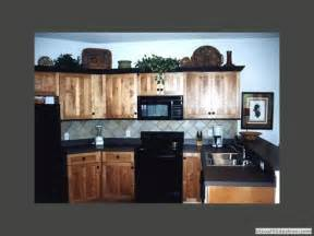 grey kitchen backsplash exle of hickory with black black counter top and grey
