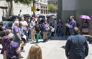 Union members, librarian protest alleged firing of library ...