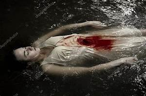 Dead girl floating in the river in dress, knife wound ...