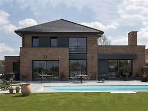 Maison cubique enduit et briques grises for Exceptional entree de maison exterieur 4 maison cubique enduit et briques grises