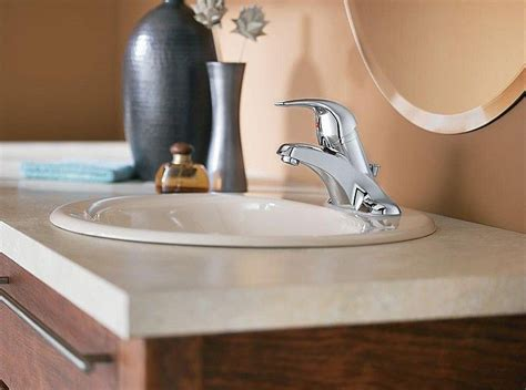 installing   bathroom faucet    vanity top
