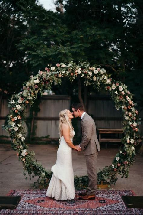 picture   oversized circle floral  greenery arch