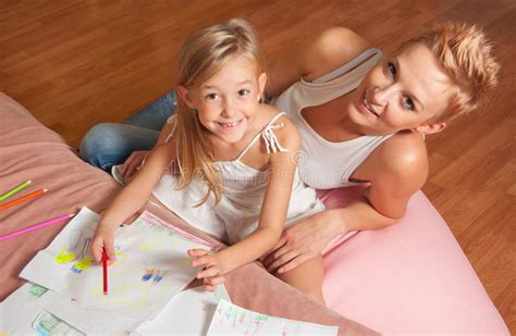Happy Mother And Daughter Drawing And Having Fun Stock