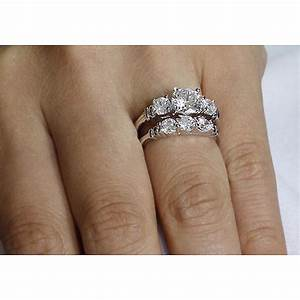 Three stone diamond wedding ring sets wedding ideas for Three stone wedding ring set