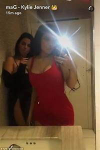 kylie jenner wears red dress as she jumps into a With kylie jenners bathroom