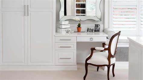 closet design ideas features white closet doors with gold
