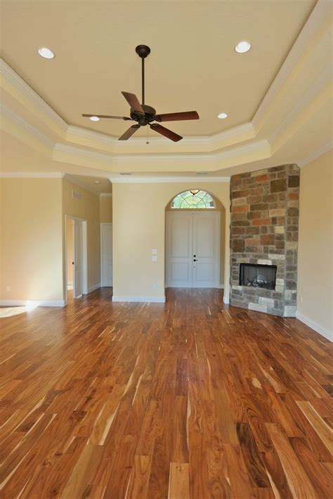 Tobacco Road Acacia Hardwood Flooring Pictures by This Home Features A Wood Burning Place And Gorgeous