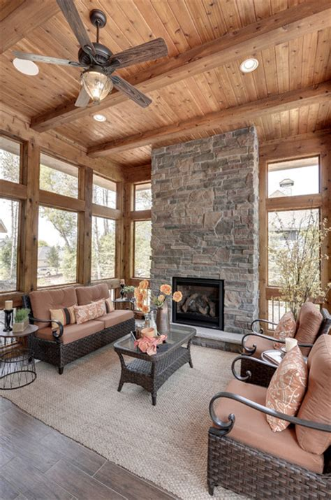 fire place in sun room 2013 luxury home inver grove heights rustic living room minneapolis by highmark builders