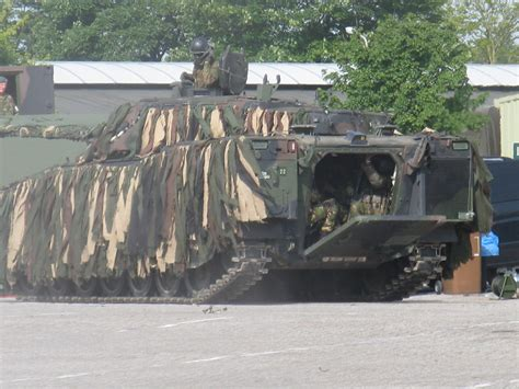 CV9035NL Camouflaged Photos Page 1