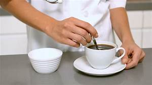 Hand Stirring Cup Of Coffee In Slow Motion Stock Footage Video 4049005