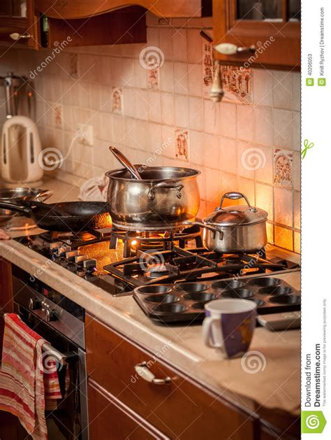 the burning kitchen pan boiling on burning gas stove on country style kitchen