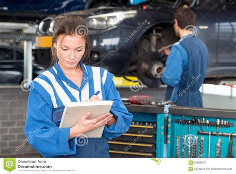 Frau In Garage by Mechanic During A Mot Test Stock Photo Image