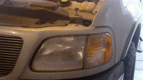how to remove a headlight bulb on a ford f150 expedition