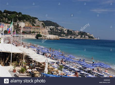France Cote D Azur Nice Sun Worshippers And Umbrellas