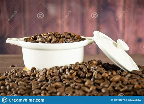 By the time coffee beans reach your cabinets, they have zero fats, carbs, or sugars. Dark Brown Coffee Beans Sweet Arabica On Brown Wood Stock Photo - Image of dark, chocolate ...