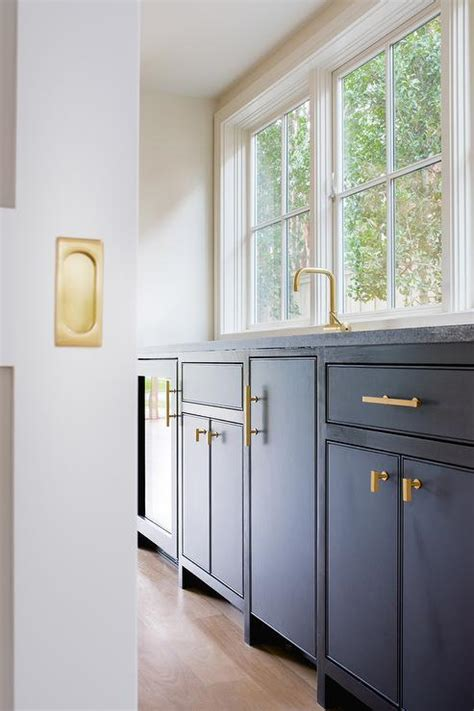 dark blue butler pantry cabinets  brushed brass pulls