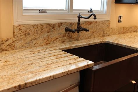 drain board cut in granite with farmhouse sink