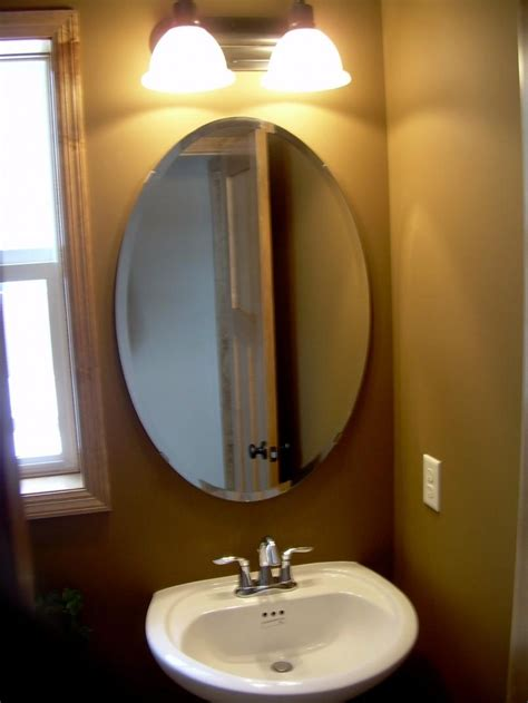 Transitional bathroom with triptych mirror. 20+ Oval Shaped Wall Mirrors   Mirror Ideas