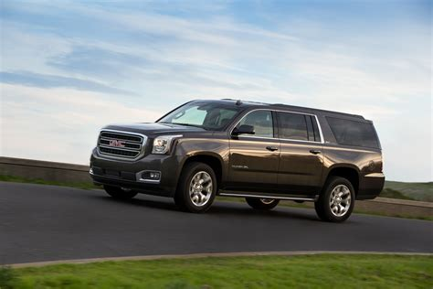 comparison gmc yukon xl   cadillac escalade