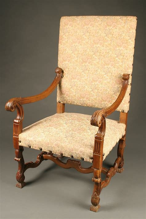 louis xiv style arm chair with stretcher base