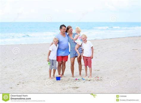 Family Of 5 Enjoying Vacation At The Sea Stock Photo