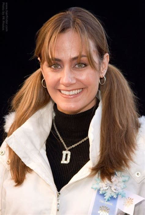 Diane Farr's youthful 80's and 70's look with pigtails and