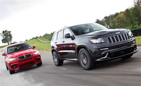 bmw jeep 2012 bmw x5 m vs jeep grand cherokee srt8 mercedes benz