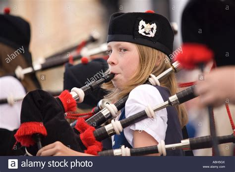 Pipe Band Young Girl Playing The Bagpipes On Annan High