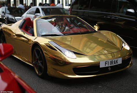 gold ferrari heads fleet of super sports cars taking over