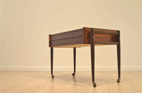 Mid Century Danish Rosewood Side Table On Wheels For Sale