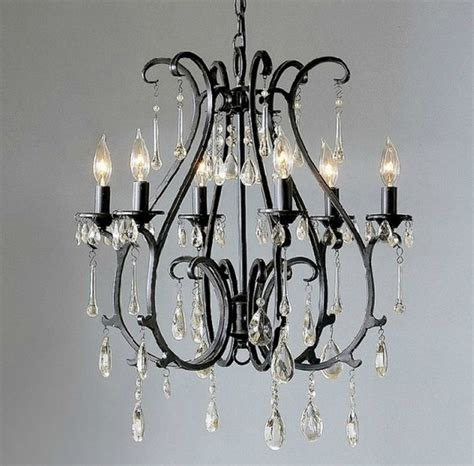 black wrought iron and chandelier interior
