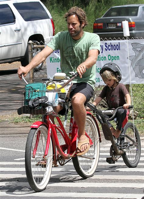 Pictures Of Jack Johnson And His Son Riding Bikes In