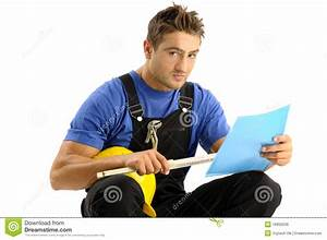 Young Worker Reading Instructions Royalty Free Stock Image