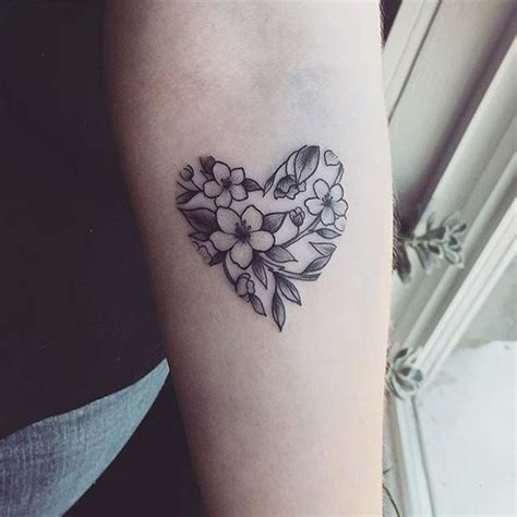 floral heart design  flower tattoo ideas  women
