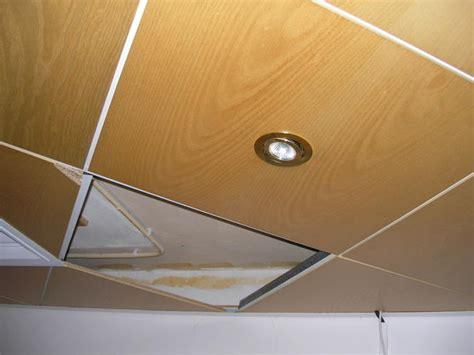 systeemplafond woonkamer opnieuw leggen bestaand systeemplafond houten panelen