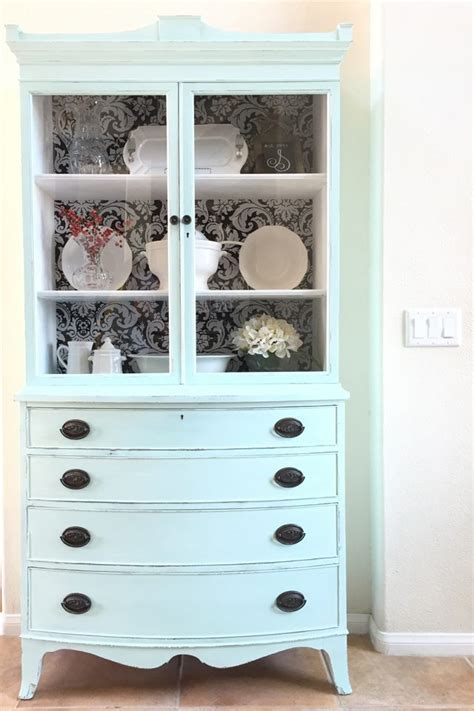 starch and hutch antique hutch makeover with fabric wallpaper back