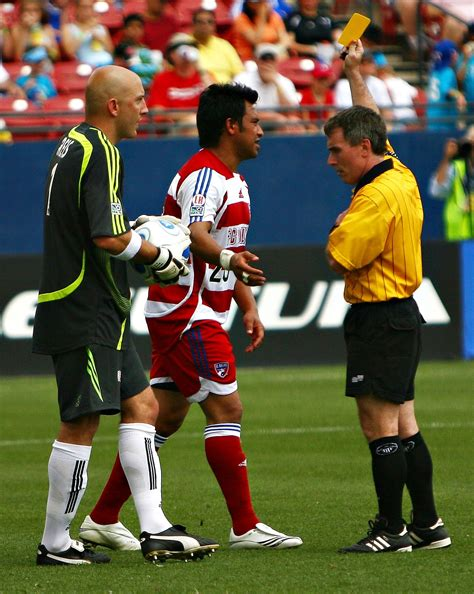 Red and Yellow Card Soccer Referee