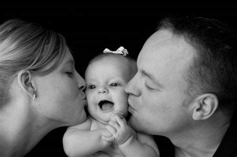 Parents Kiss Baby Girl Wallpapers Hd / Desktop And Mobile