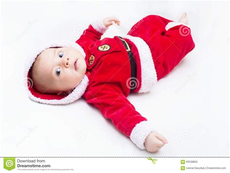 red santa sack for babies pictures baby wearing a and white santa hat stock photo cartoondealer 22719108