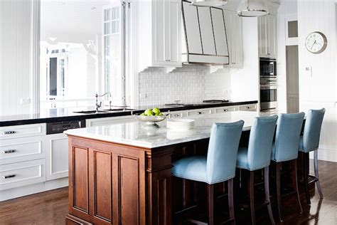 kitchen islands with cooktop kitchen pass through window with brass half moon stools 5272
