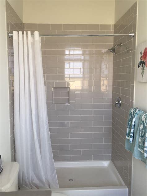 grey  white guest bathroom  warm grey tiled walk