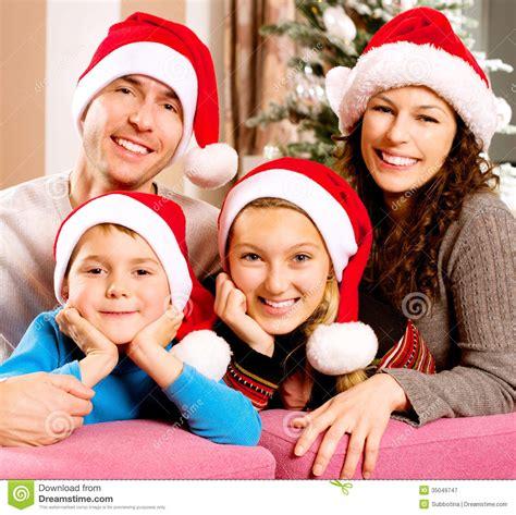 family near the christmas tree royalty free stock
