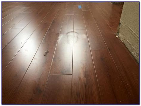 pergo flooring buckling replacing laminate flooring water damage flooring home design ideas 9wpreandq197436